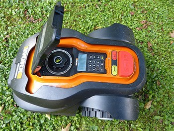 a smart automatic lawn mower with control panel lid open