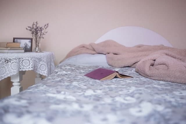 book and blanket on bed